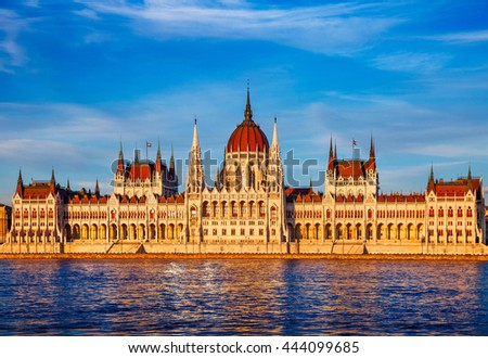 Sunset evening with building of hungarian parliament at Danube river in Budapest city, Hungary. National government house for state Parliament on the banks of Budapeste Europian old town. - stock photo