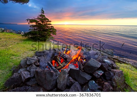 Sunset fire along the beautiful beach of Lake Superior in northern Michigan