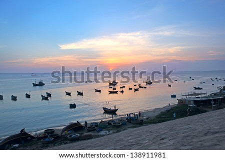 Sunset. Fishing boats in Mui Ne harbor. Vietnam - stock photo