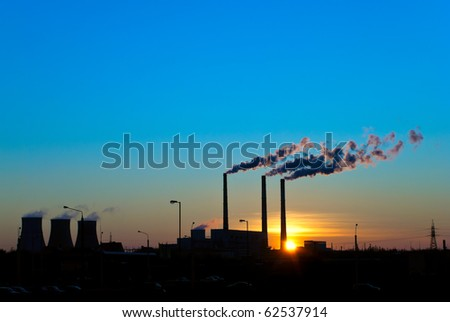 Sunset for smoking factory pipes - stock photo