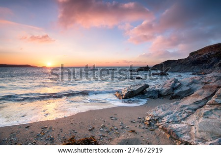Sunset from Little Fistral beach, a small sheltered cove beneath the Towan headland at Newquay on the Cornish coast - stock photo