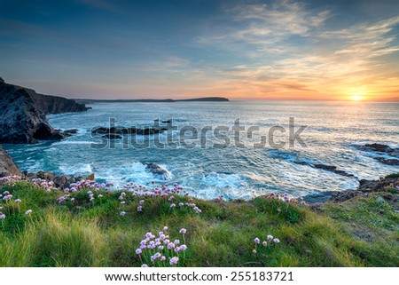 Sunset from the clifftop at Longcarrow Cove near Padstow on the north coast of Cornwall - stock photo
