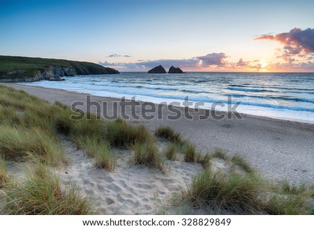 Sunset from the dunes at Holywell Bay on the Cornish coast - stock photo