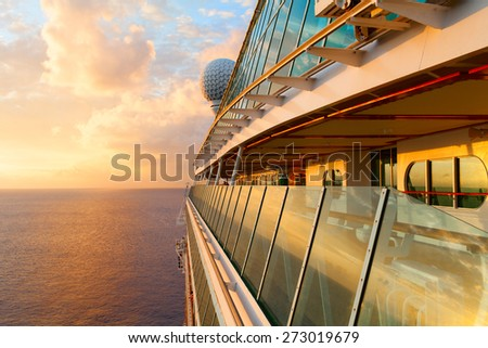 Sunset from the open deck of luxury cruise ship. - stock photo
