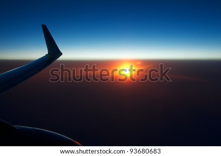 Sunset from the plane. - stock photo