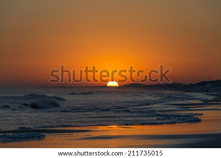 Sunset from the sea cost - stock photo