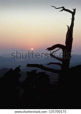 Sunset from the top of Mt. Scott in the Wichita Mountains National Wildlife Refuge - stock photo