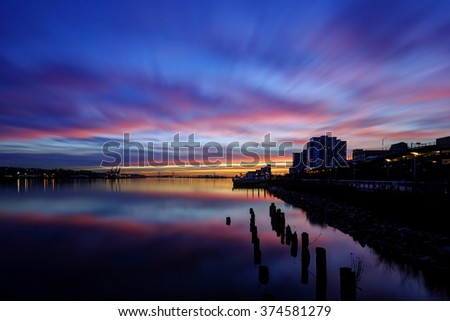 sunset glow over river and riversides - stock photo