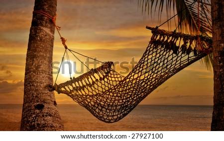 Sunset Hammock at Beach Shore - stock photo