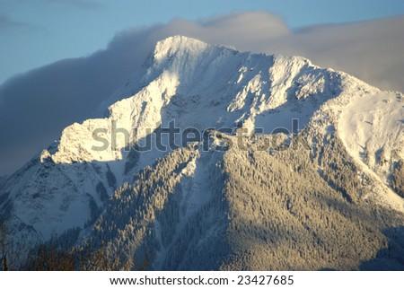 Sunset hits the upper half of Mount Cheam, Chilliwack, British Columbia - stock photo
