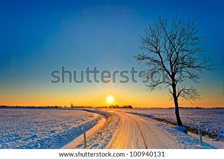 Sunset in a cold white winter landscape - stock photo