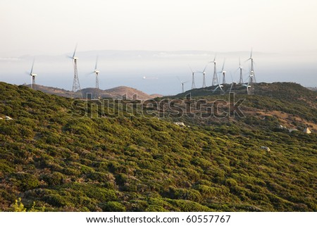 Sunset in a field of wind turbines in southern Spain - stock photo