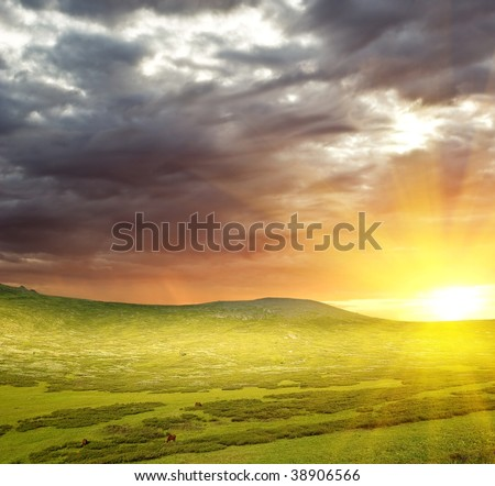 sunset in a green hills