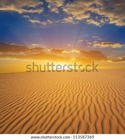 sunset in a sand desert - stock photo