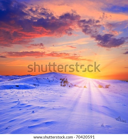 sunset in a winter snowbound plain - stock photo