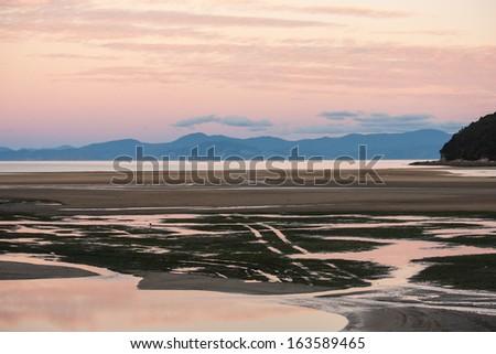 sunset in Abel Tasman National Park - stock photo