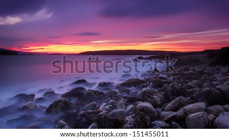 Sunset in Acadia national park, ocean long exposure with smooth water and colors - stock photo