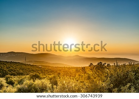 Sunset in Ajloun, Jordan. It is located about 76 km north west of Amman, with Israel visible. - stock photo