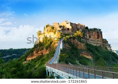 Sunset in Bagnoregio town fortress in Lazio, Italy  - stock photo