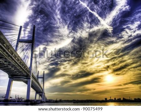 Sunset in Bay Bridge at Daikoku Pier in Yokohama, Japan. - stock photo