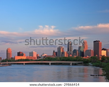sunset in downtown Minneapolis with Mississippi river - stock photo