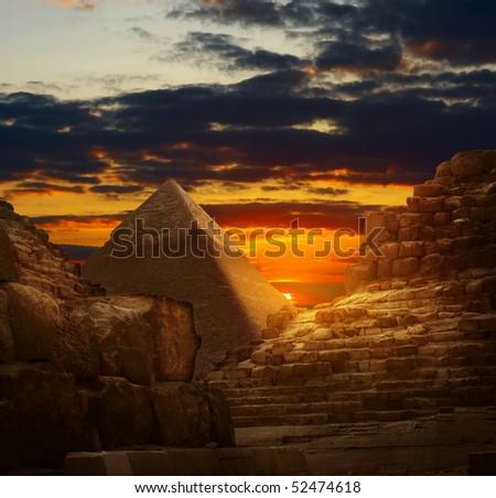Sunset in Giza pyramids - stock photo