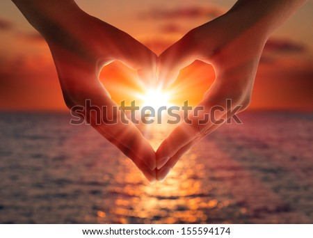 sunset in heart hands