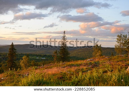 Sunset in Hills. Finland, Lapland - stock photo