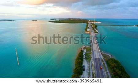 Sunset in Islamorada, Florida. Bridge over the sea, aerial view - stock photo