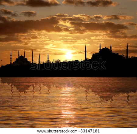 Sunset in Istanbul silhouette with Blue Mosque and The Hagia Sophia - stock photo
