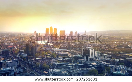 Sunset in London, Canary Wharf business district  - stock photo