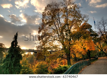 Sunset in Luxembourg in autumn with view of Ponte Adolphe - stock photo