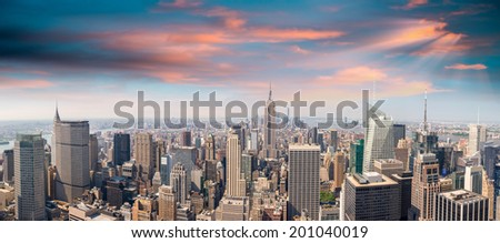 Sunset in Manhattan. Midtown and downtown aerial view - New York City. - stock photo