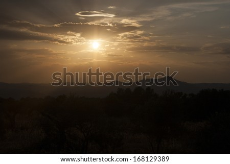 Sunset in mountains - stock photo