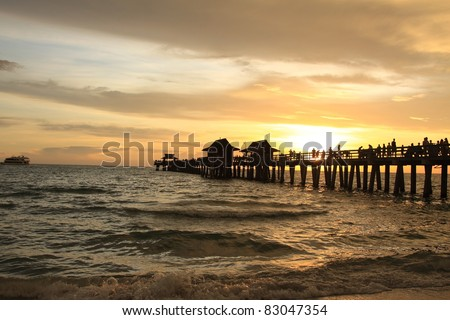 Sunset in Naples pier on beach Golf of Mexico, Florida - stock photo