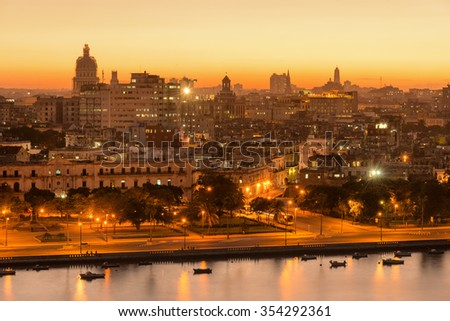 Sunset in Old Havana with a view of  the bay and the Capitol building - stock photo