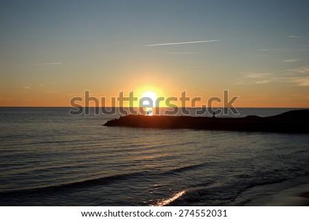 sunset in Ostia beach, Rome, Italy - stock photo