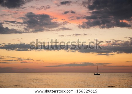 Sunset in pastel colors over the Black Sea - stock photo