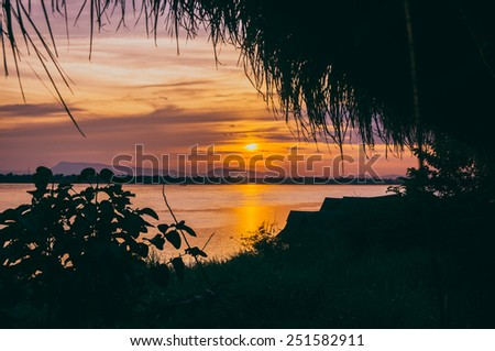 Sunset in river Mekong - stock photo