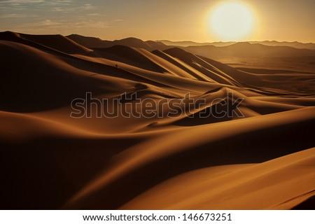 Sunset in Sahara Desert - stock photo