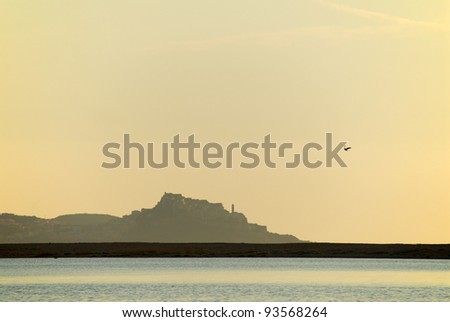 Sunset in Sardinia (Castel Sardo).  Italy - stock photo