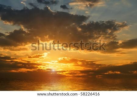 sunset in sea - stock photo