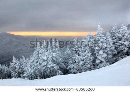 Sunset in ski resort mountains Stowe, VT - stock photo