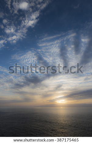 Sunset in the Atlantic ocean - stock photo