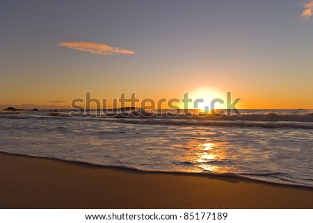 Sunset in the Atlantic Ocean at Cape Town, South Africa - stock photo