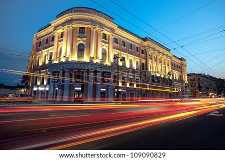 Sunset in the city. Lights cars. (Downtown St. Petersburg, Russian Federation) - stock photo