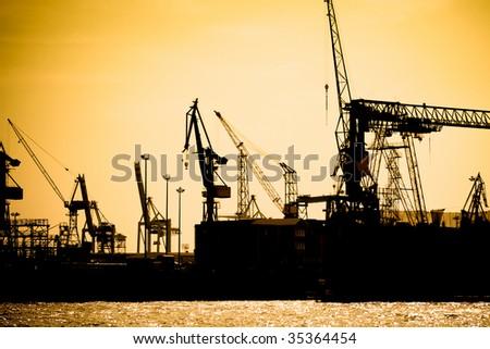 Sunset in the harbor of Hamburg (Germany) - stock photo