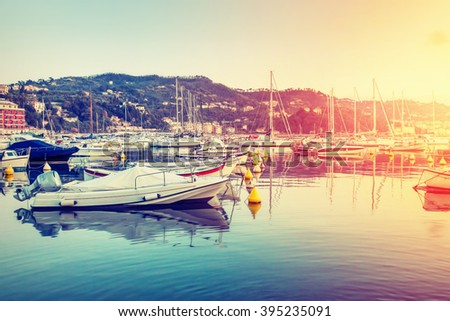 Sunset in the harbor of Lerici, Liguria, Italy. Filtered image. - stock photo