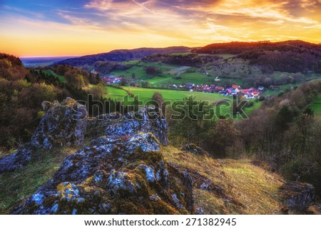 Sunset in the jurassic hills of Upper Franconia, Germany. Lovely Spring evening in the rural countryside near Bamberg. European Scenery. Landscape Picture - stock photo