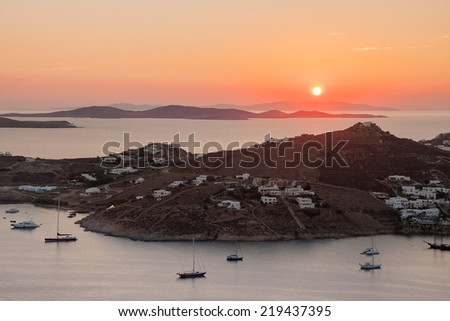 Sunset in the Mediterranean - Greek islands with small villages and yachts near the shore. Mykonos. - stock photo